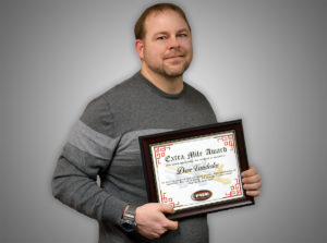 Dave Vanderlee holding his Extra Mile Award!