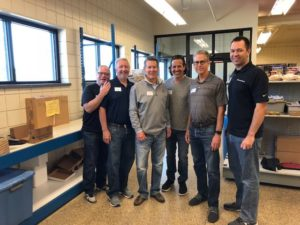 FWE President, Deron Lichte, stands with the other NAFEM Executives as they prepare to volunteer at the Madison St. Vincent de Paul Food Pantry.
