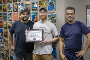 David Hunter (Center) shown with Virgil (left) and Arturo (right) after accepting award.